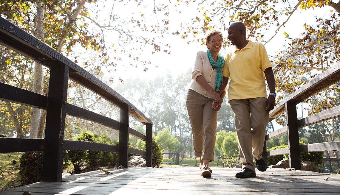 Mature couple walking through a prak