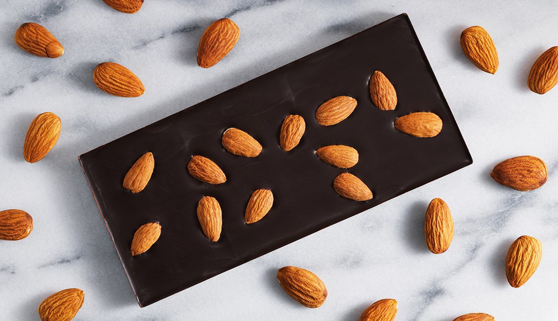 Almonds and dark chocolate on marble