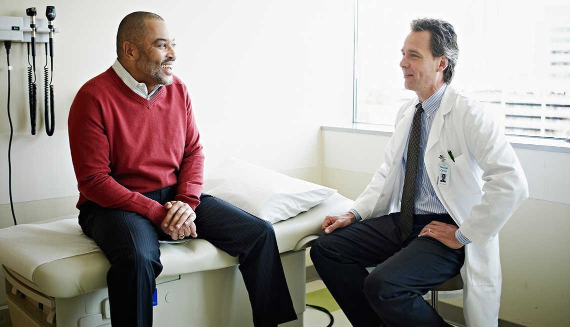 Mature male patient in discussion with doctor, Living With Medicare