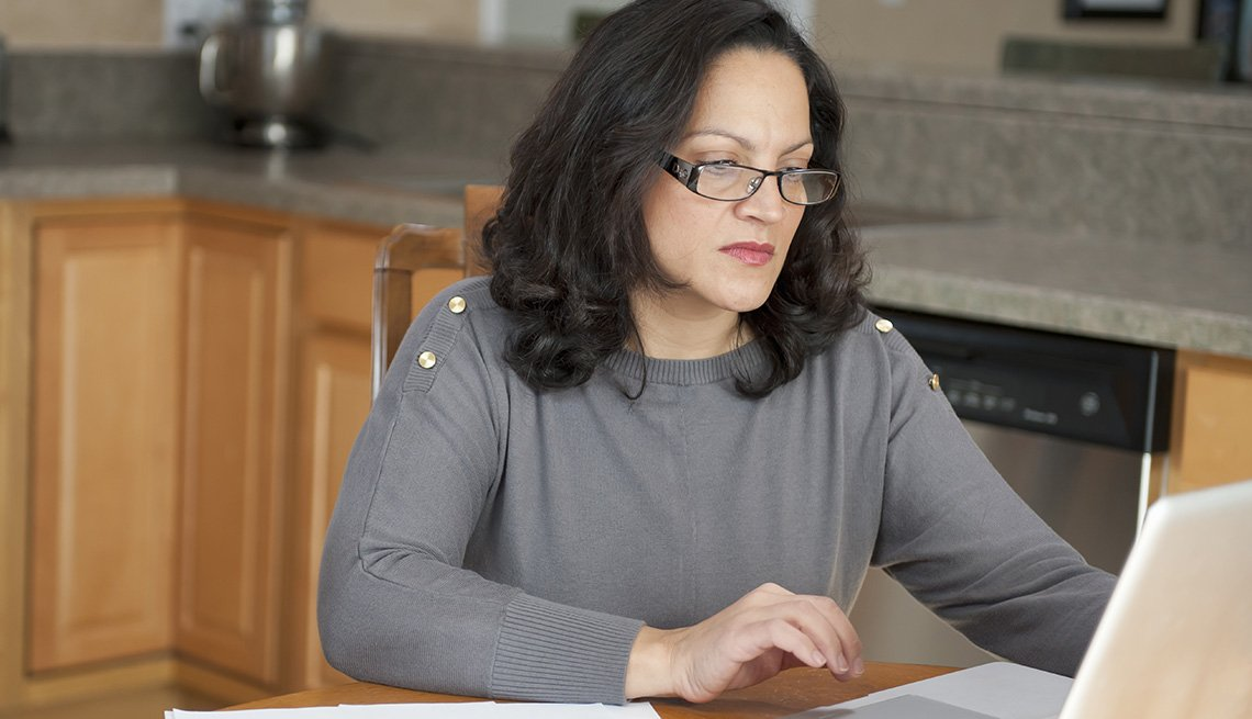 Woman Working on Computer at Home, Living With Medicare