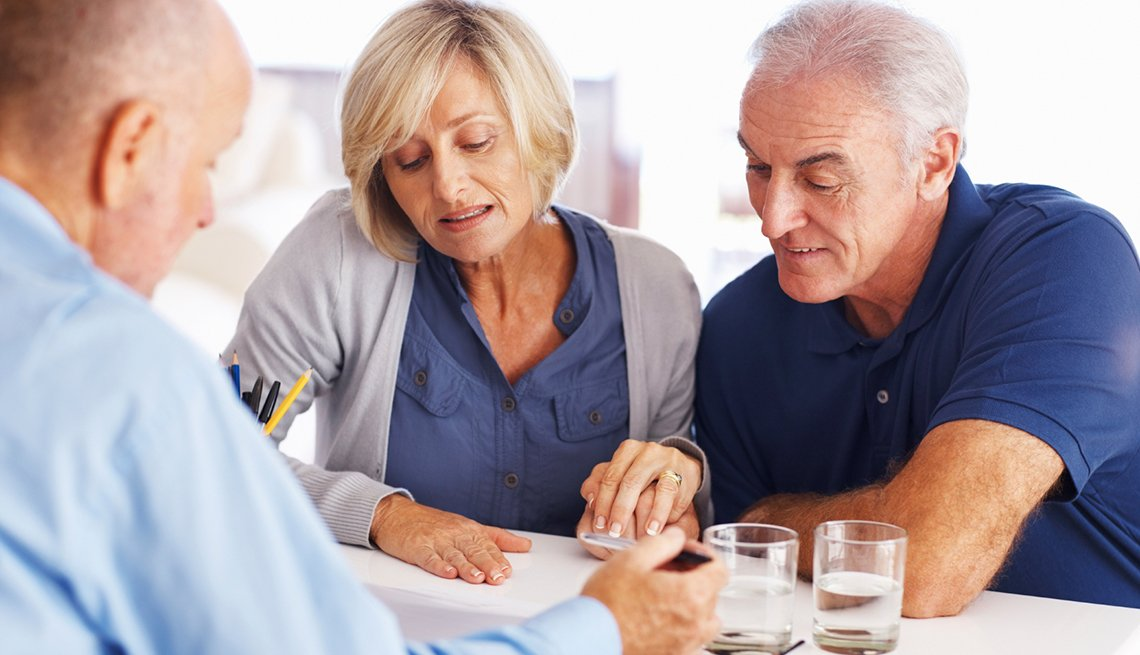 Senior couple reading insurance plans,How to Read Your Part B Medicare Summary Notice.