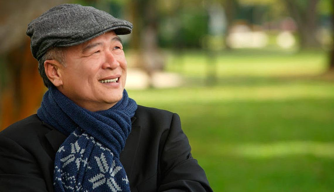 Asian American man park bench , Many Asian Americans are dependent on Social Security.