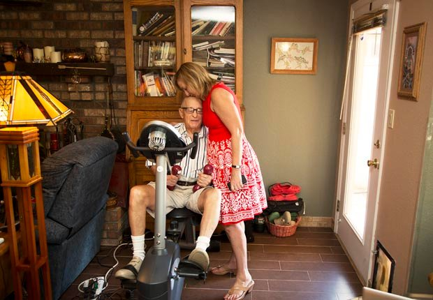 Amy Goyer kisses her father's forehead, Juggling Work and Caregiving (Beth Perkins Photography)