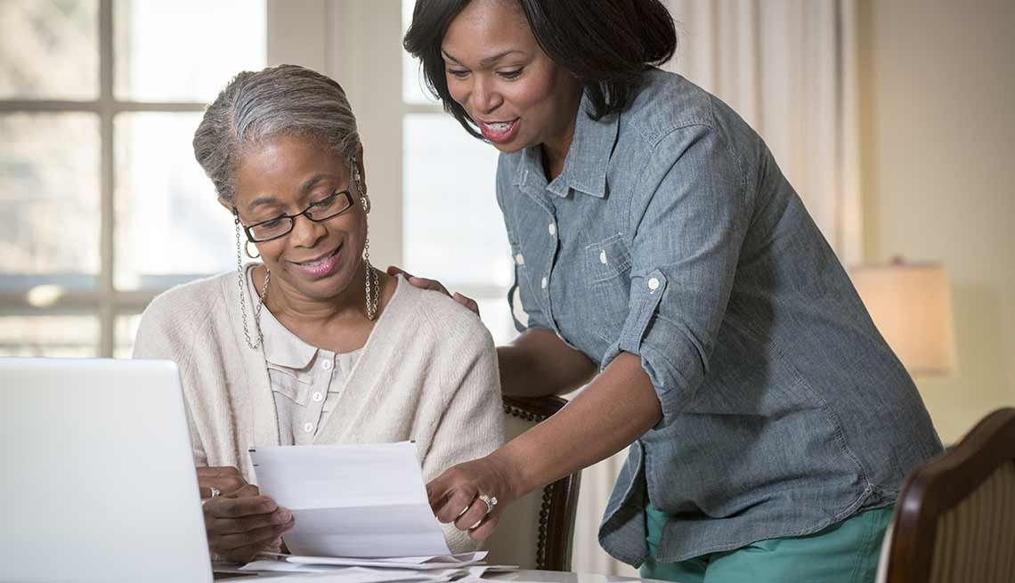 Daughter helping mother pay bills, Having the Financial Talk with Your Folks