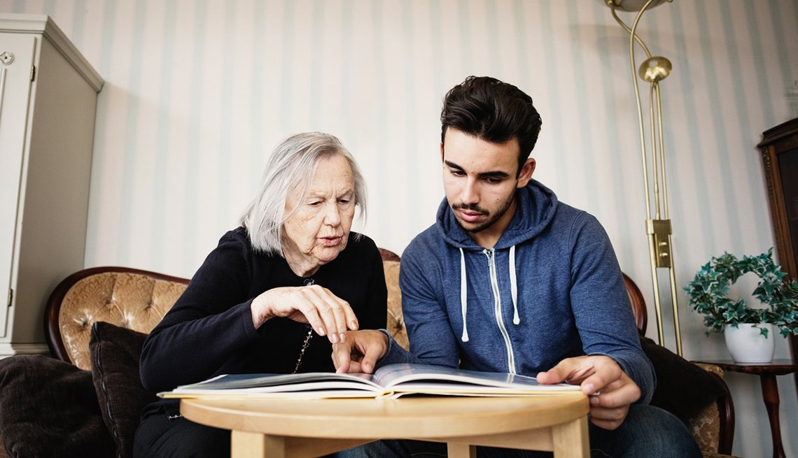 woman and man looking at album: first time caregiving