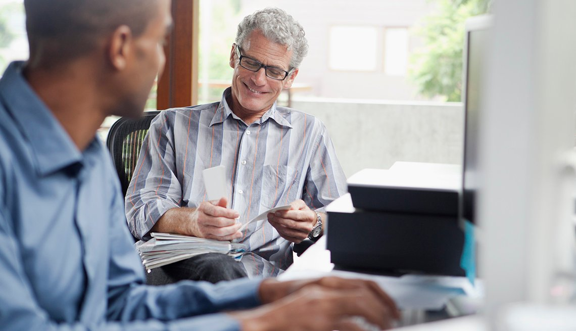 Two Men in An Office, Coworkers Talking, What Working Caregivers Must Know