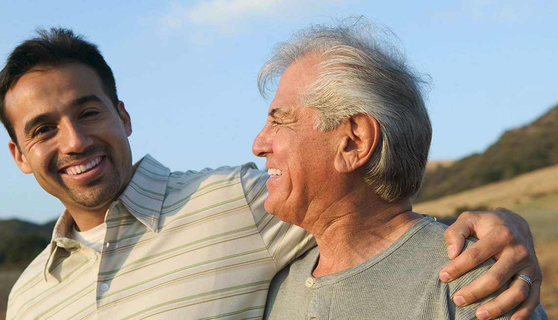 Father and son, smiling together, sunny day, Respect a Caregiver's Time, ReACT, AARP