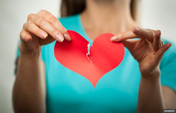 Woman tearing red paper heart, Reasons to breakup dating relationship