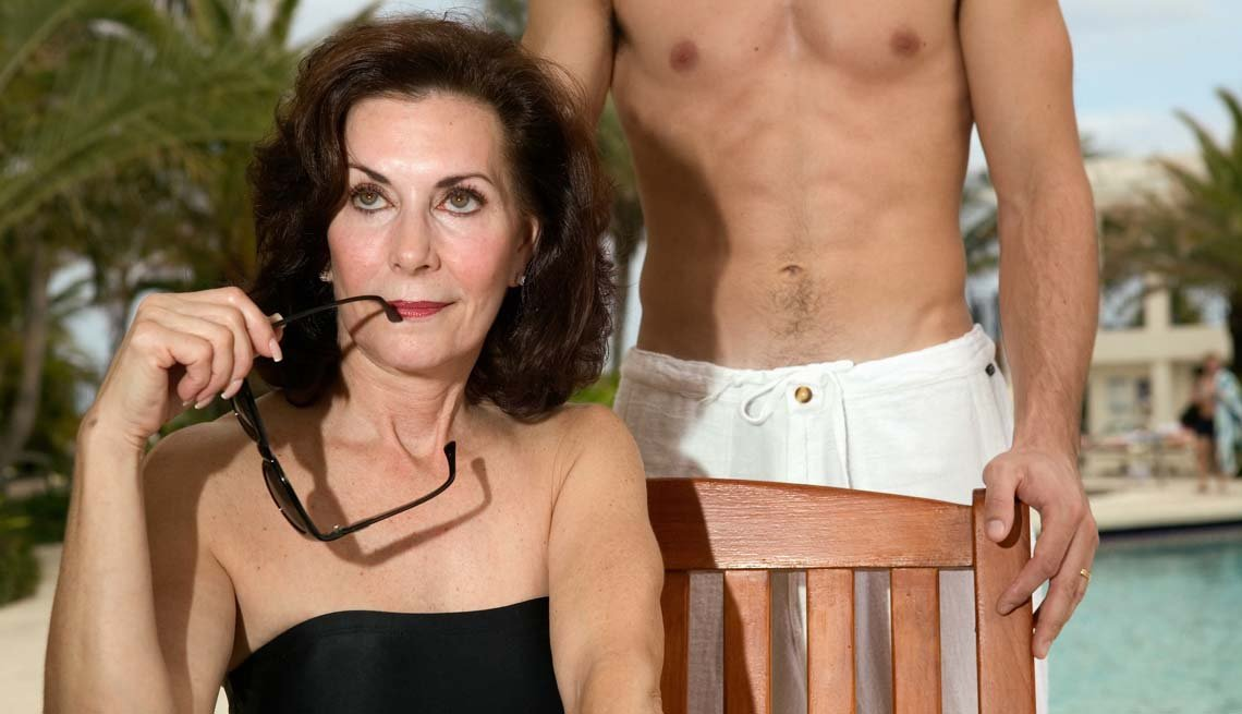 Older Woman Poolside With Young Man Nearby, How to Be a Cougar