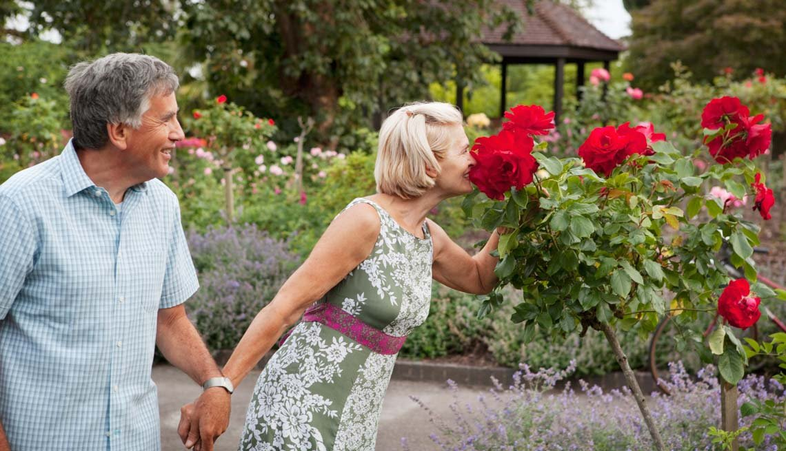 Woman Smelling Flowers While Holding Man's Hand, When Mom's Got a New Boyfriend