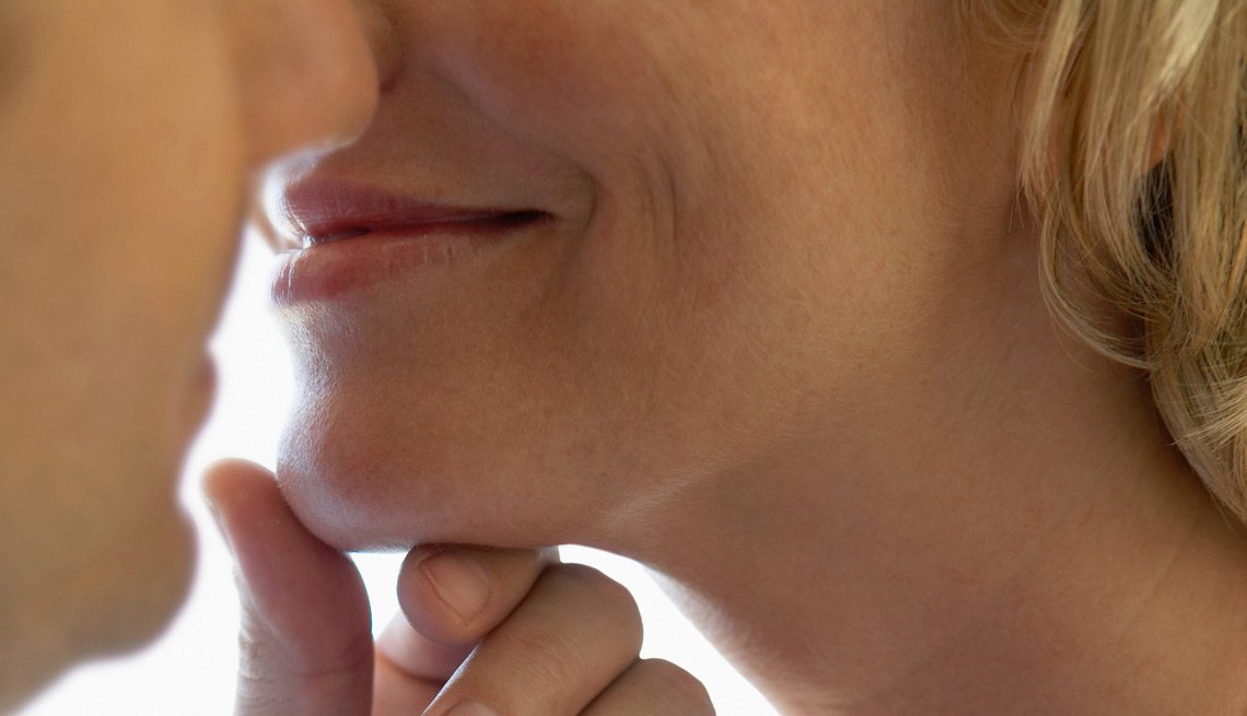 Man Touching a Woman's Chin Before a Kiss, How Does Love Affect Your Body?