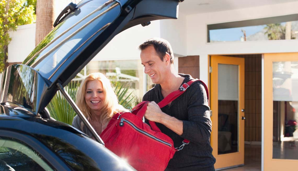 Man and Woman Packing Car with Overnight Bag, 5 Tips for Your First Overnight Date