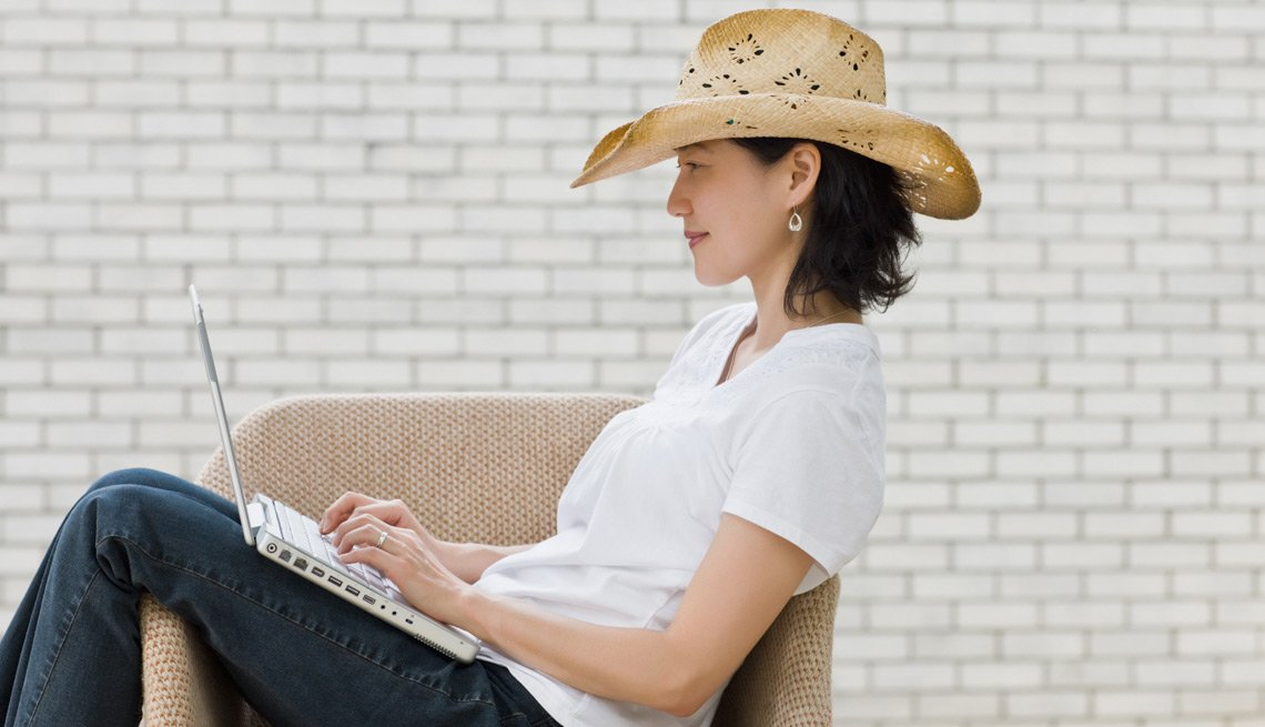 Woman Sitting With Her Laptop, Ready to Try Online Dating?