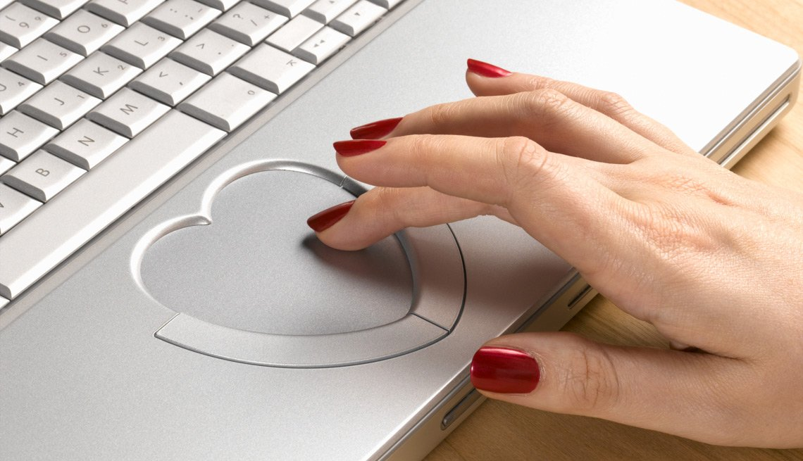Hand Using Heart-shaped Track Pad On a Laptop, How to Stay Safe While Dating