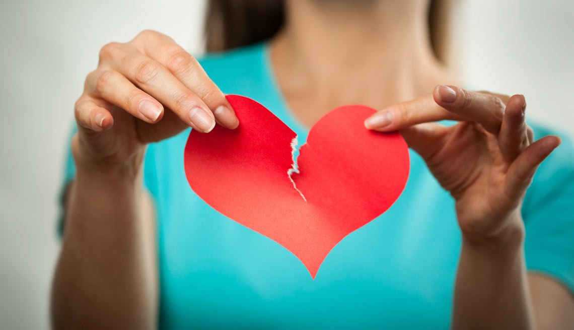 Woman Ripping a Paper Heart,  5 Reasons to Call It Quits When Dating
