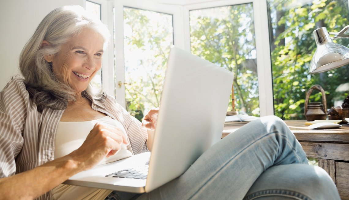 Senior woman using laptop in sunny home office, Proceed with Caution – Online Dating Tips