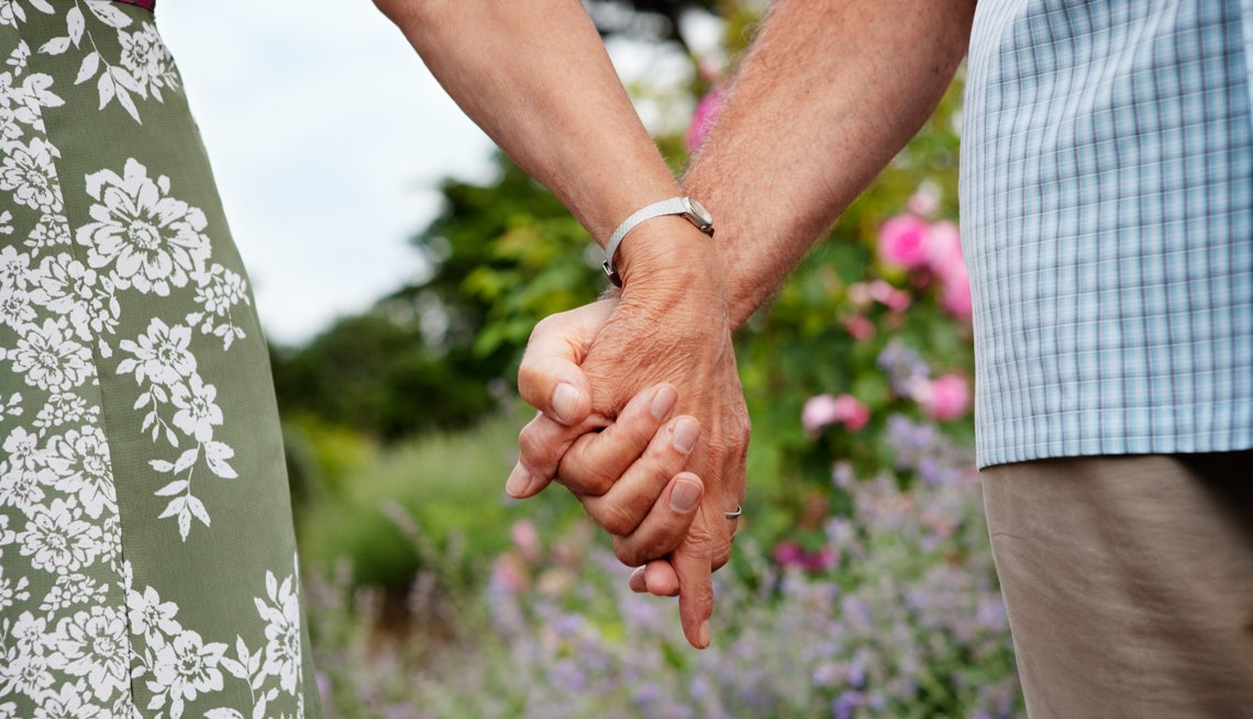 Close-up of mature couple holding hands, Relationship Advice Is She Really Going Out With Him