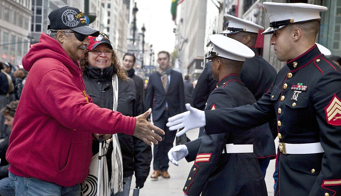 Veterans and current military receive handshakes and thank yous during the Veterans Day Parade in New York City