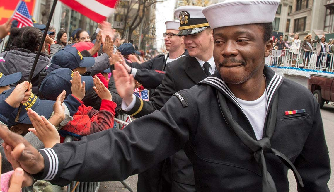 U.S. Navy Sailors greet people gathered for the annual Veterans Day parade during Veterans Week in New York City