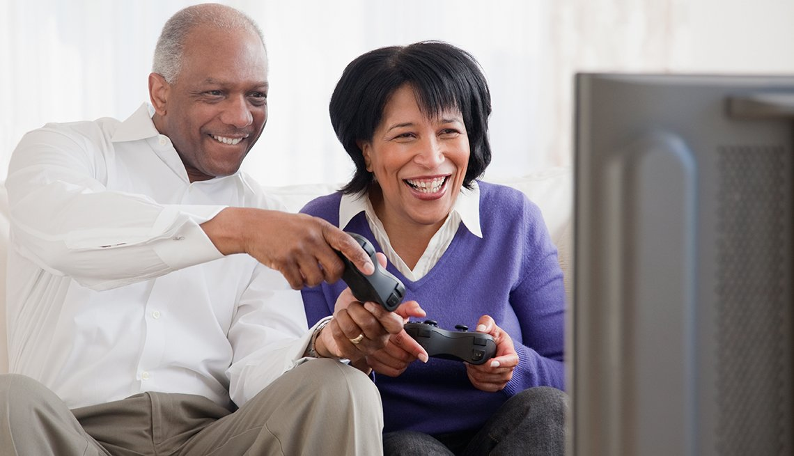 African American couple playing video games