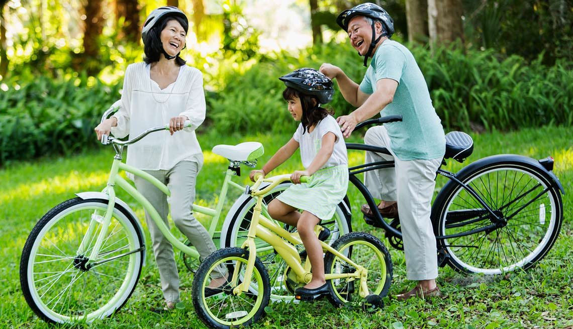 Little girl riding bicycles with grandparents, Grandparents raising grandchildren