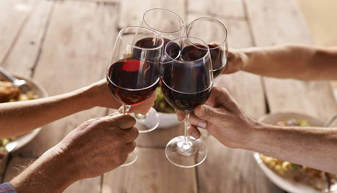 Toasting with glasses of red wine