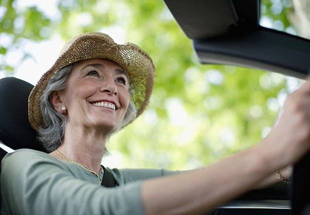 Woman driving convertible car wearing hat,6 things you need to know about buying and owning a convertible