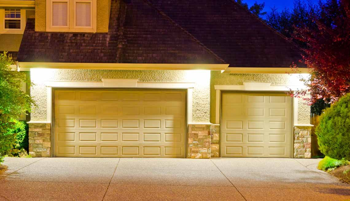 House driveway lit by motion sensor lighting, 10 Ways to Add a Curb Appeal to your Home