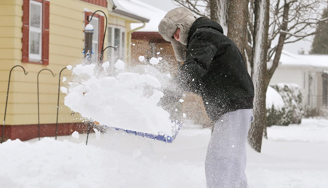 Man shoveling sown, Livable Neighborhoods, Virginia, Minnesota