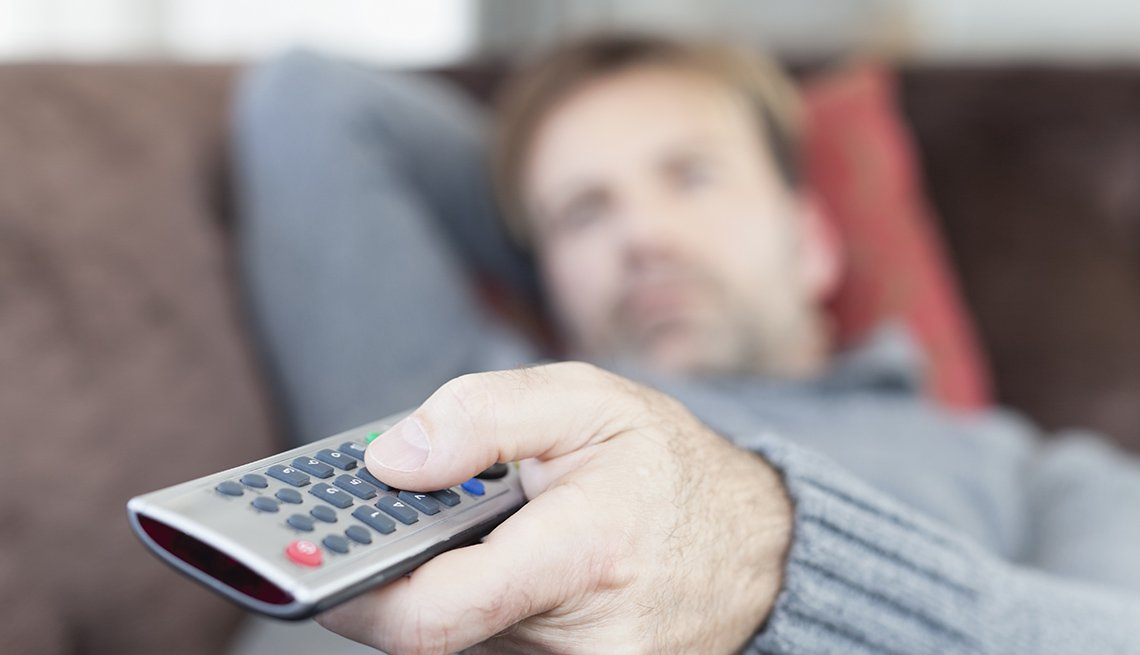 Man Holds Television Remote, AARP Home And Family, Personal Technology, 13 Items That Have Been Replaced By The Smartphone