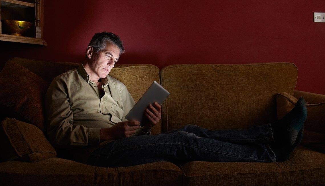Man watching TV on his Ipad