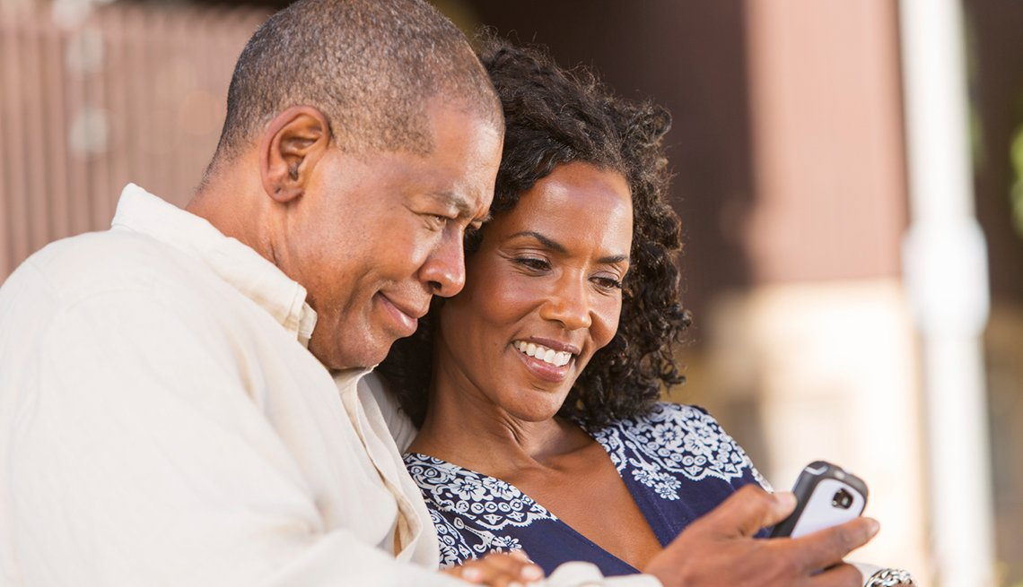 Mature couple using phone application