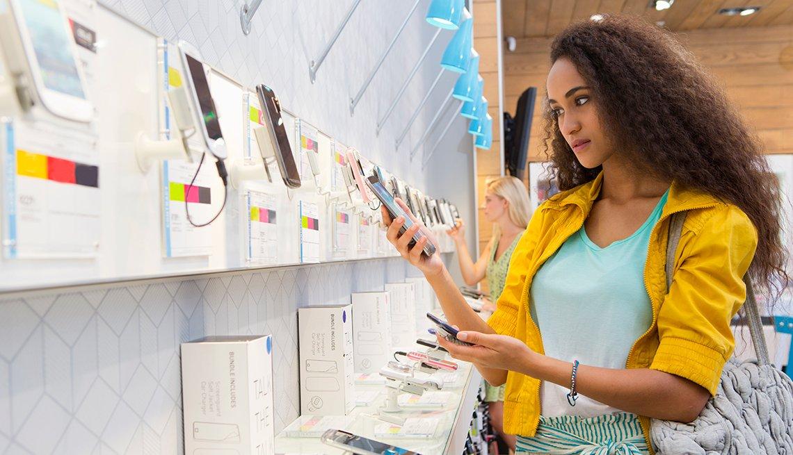 Woman shopping electronic store