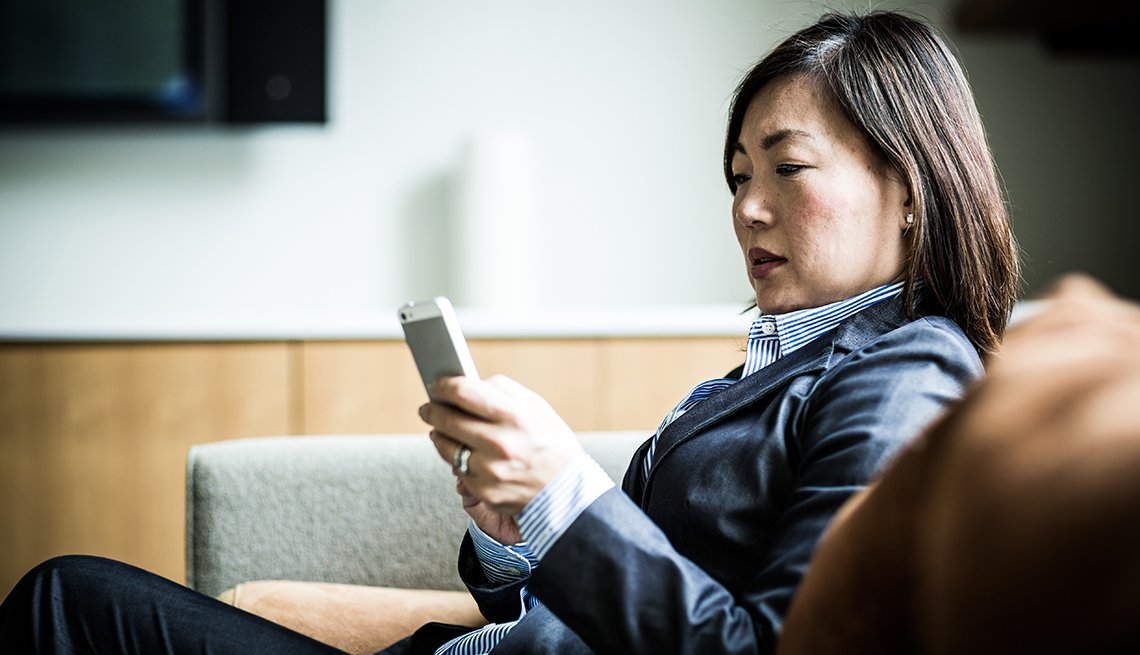 Woman using cell phone on the couch