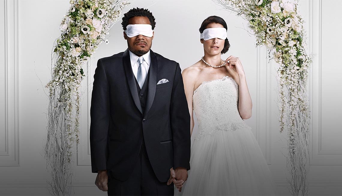 a couple blindfolded at the alter. love and marriage.