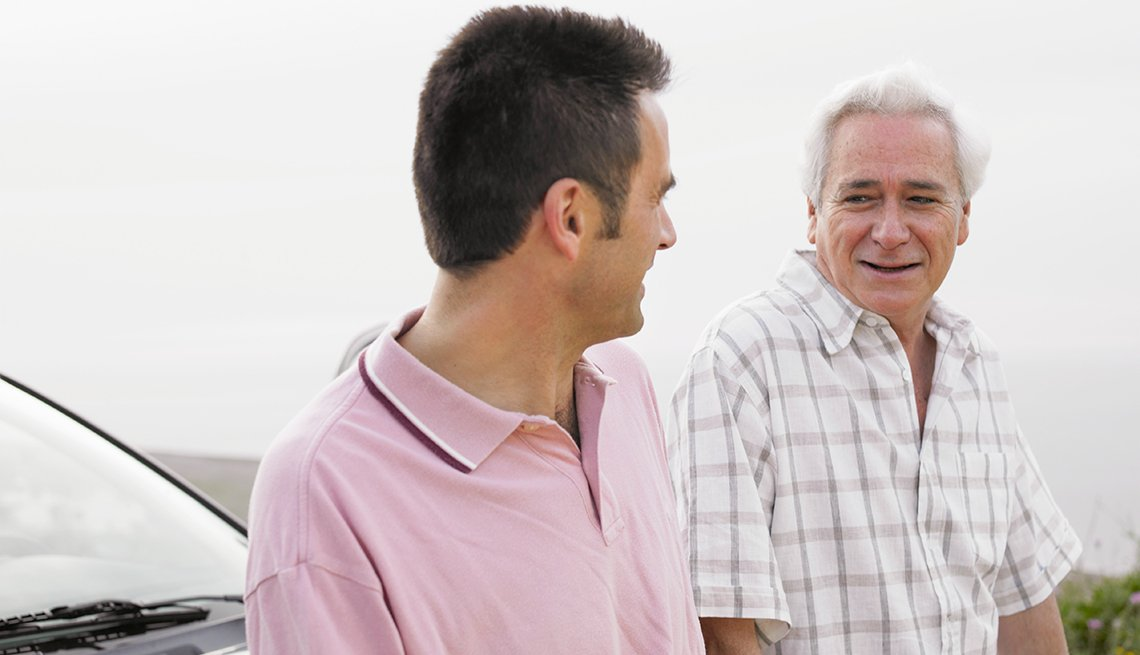 Mature man and adult son, standing beside car, talking, We Need To Talk, AARP Driving Reource Center