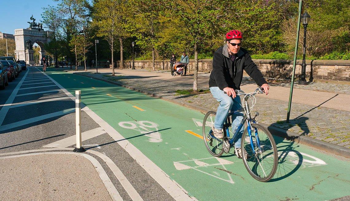 Man Rides His Bike In The Dedicated Bike Lane In Street, City, Urban Setting, Trees, In Livable Communities Slideshow