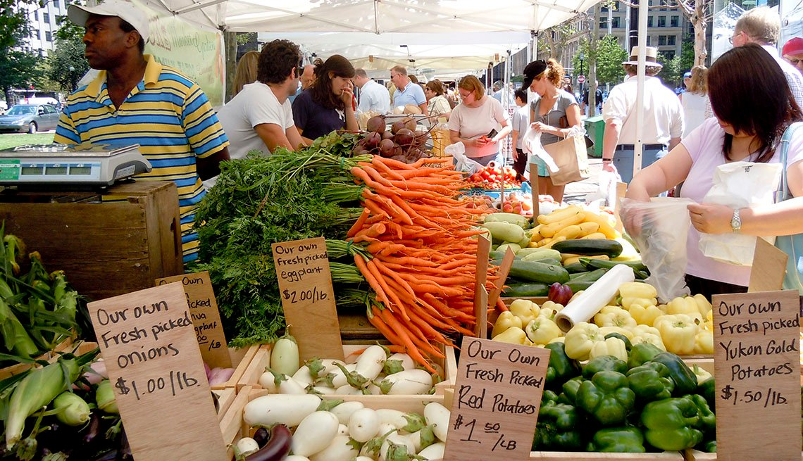 People Shopping For Fresh Fruits And Vegetables At Local Farmers Market, Vendors, In Livable Communities Slideshow