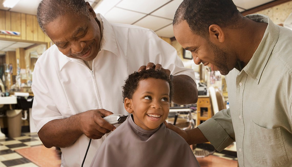 Young Black Boy Smiles At His Dad While He Gets A Haircut At Barbershop, Barber, Dad, In Livable Communities Slideshow