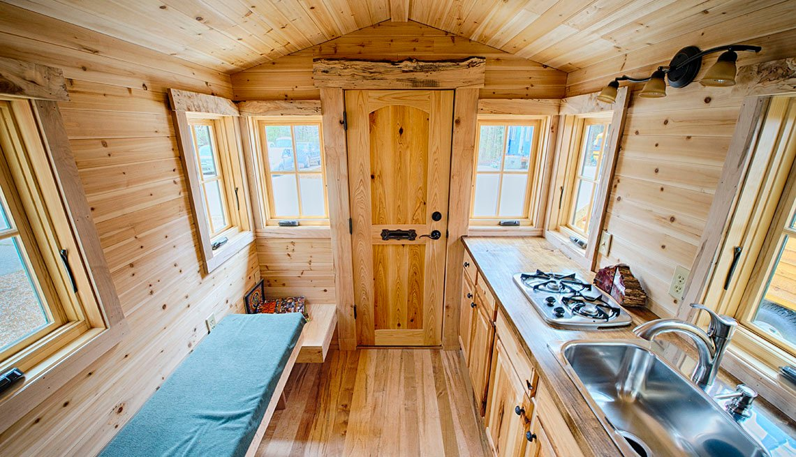 Wide View Of An Interior Tiny Home With Front Door Flanked By Bench, Sink And Cooktop And Windows All Around, Tiny Homes, Livable Communities