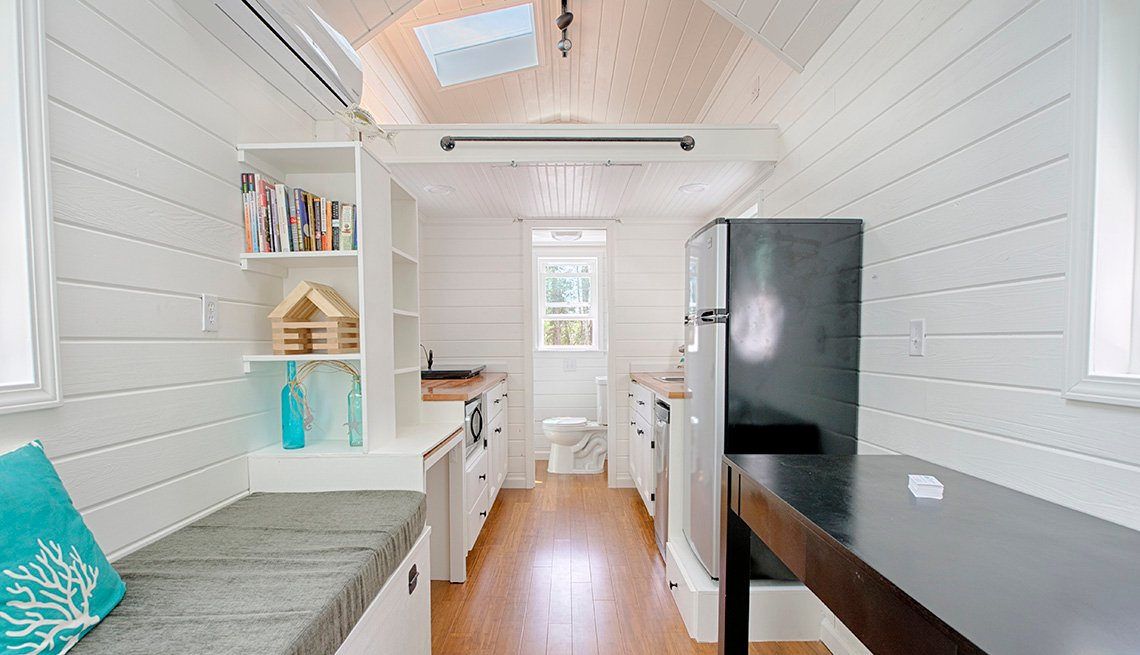 Interior Of Tiny Home With Loft Space For Sleeping, Toilet, Galley Style Kitchen, Table And Bench, Tiny Homes, Livable Communities