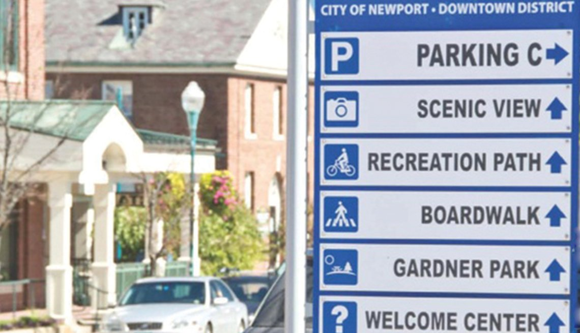 City of Newport Downtown District direction sign to parking, scenic view, recreation path, boardwalk, Gardner Park, welcome center