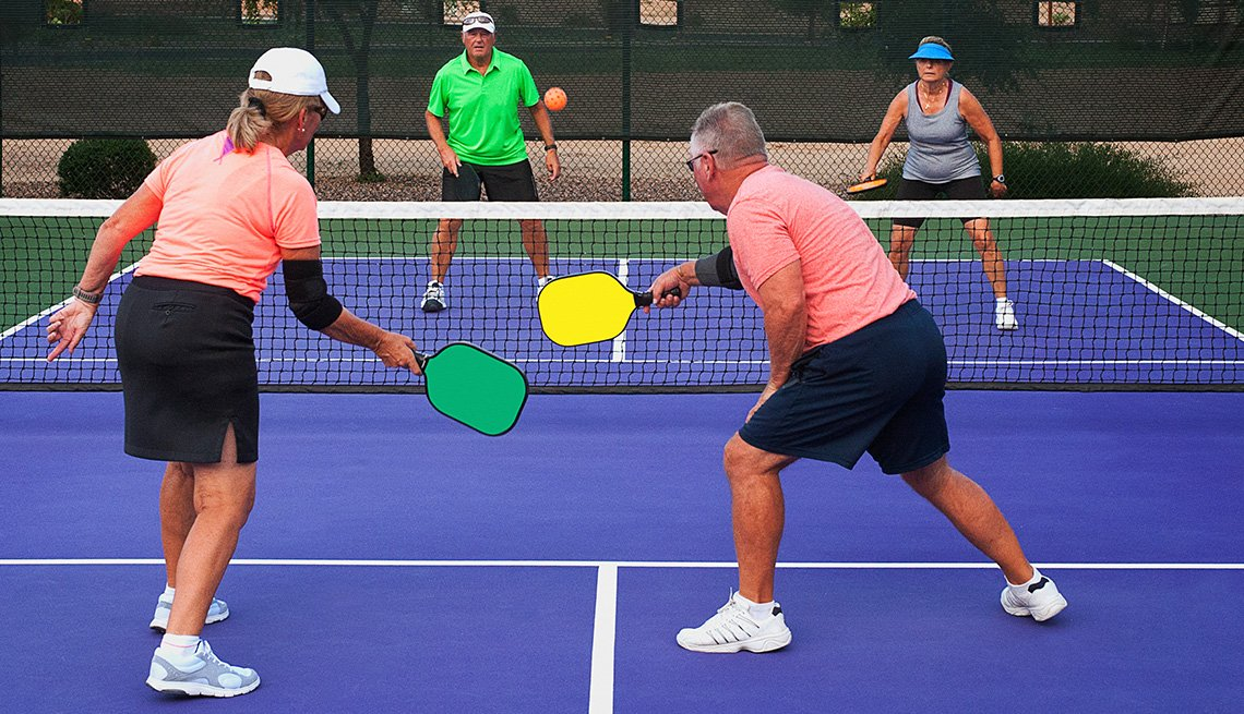 Two couples play pickleball, a game that's kind of like tennis and has nothing to do with pickles