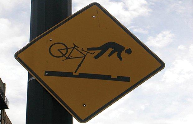 A hazard sign warning bicyclists in Portland, Oregon, of streetcar tracks in a roadway