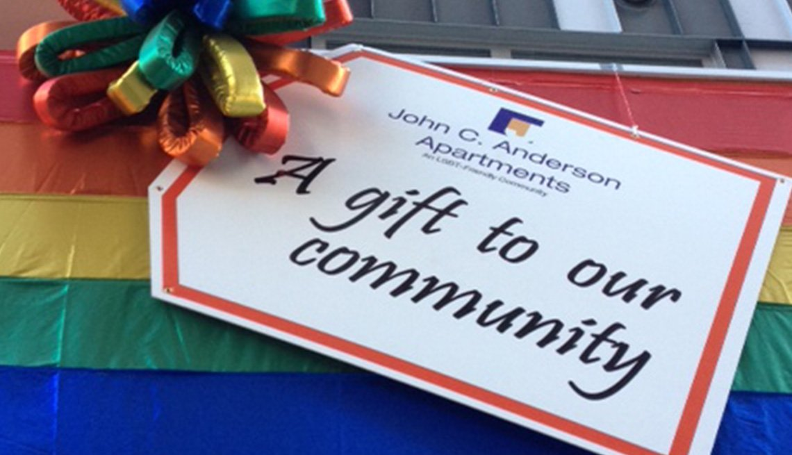 A gift tag on the John C. Anderson Apartments that says A Gift to Our Community