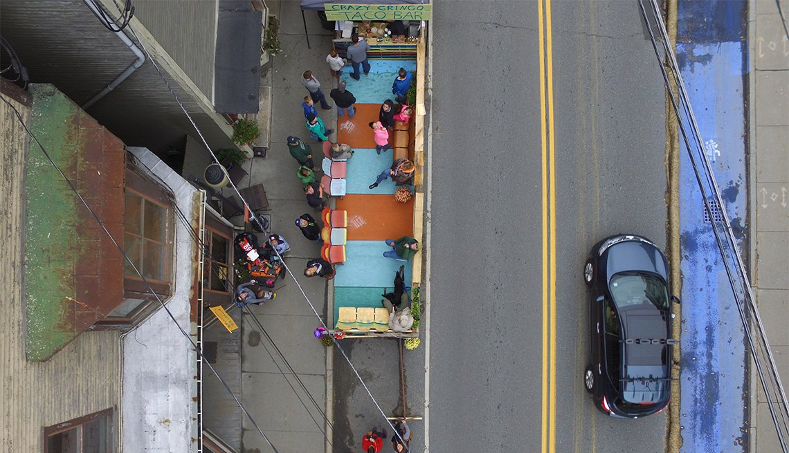 An aerial view of the Blue Land and sidewalk parklet.