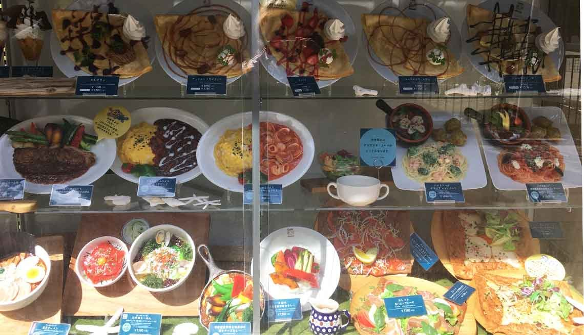 A plastic food display in the window of a restaurant in Japan.