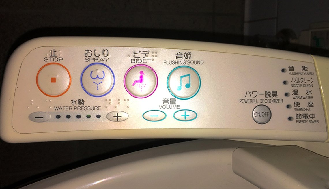 The push button controls on a high-tech toilet in a Japanese rest room
