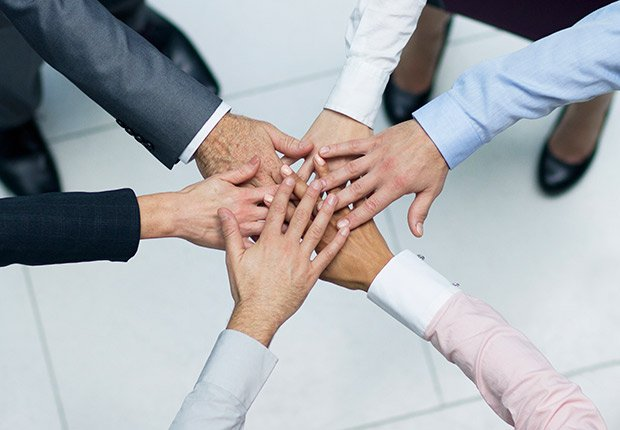 We - people put their hands together as teamwork