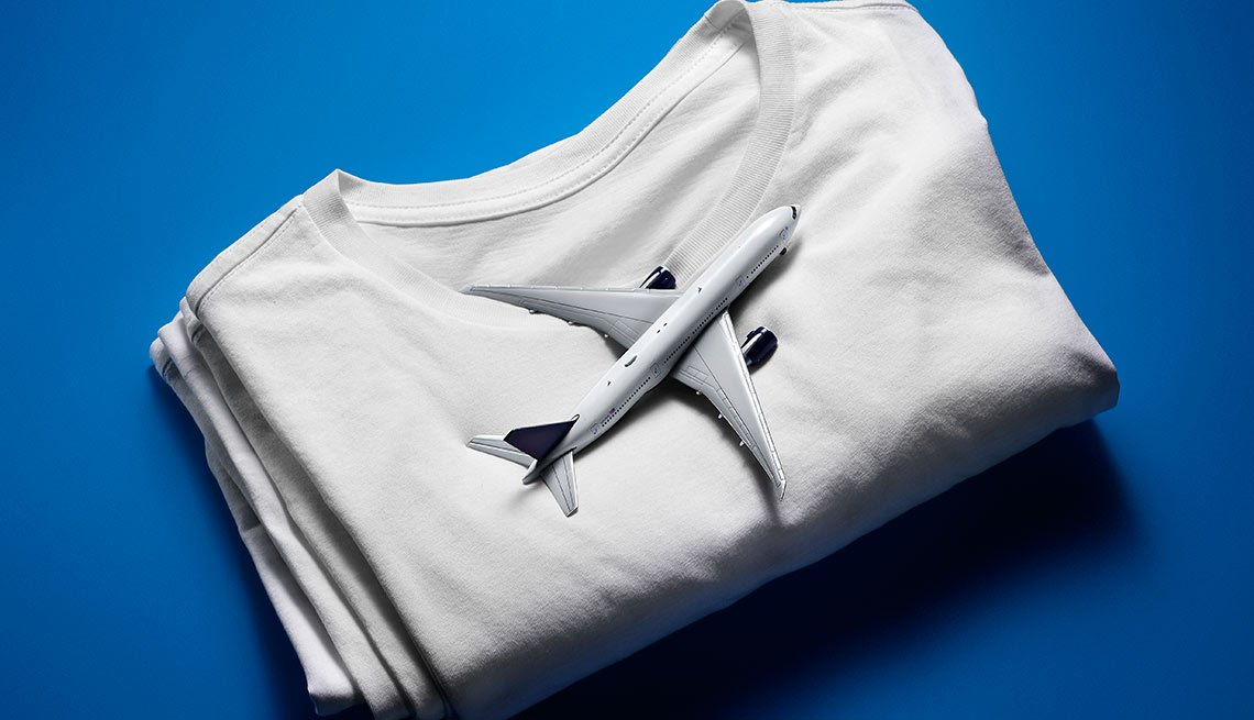 Want to get more for the money you spend on clothing? Shop through airline miles programs or rebate sites.
